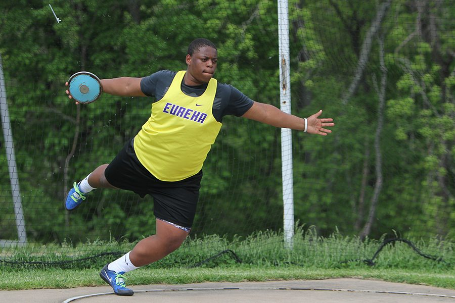"Districts underway, Jamal Pittman, discus and shot put, throws a disc during the boys district track meet, May 11. ""I enjoy all my teammates who watch my events,"" Pittman said. ""Their personalities are exactly what you want in friends. I am excited for the competition at sectionals. Right now I am seeded fifth in my district. It was lower than I was originally seeded, but I am ready to win."" Pittman qualified for sectionals, May 19."