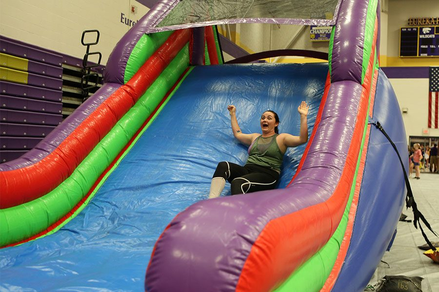 Shelby Wright (12) goes down the slide during Senior Celebration.