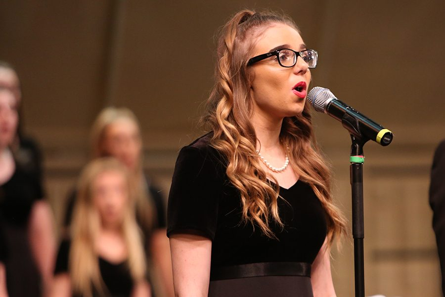 "Pop songs picked, Emily Dean, mixed chamber choir, sings ""Firework"" by Katy Perry at the choir concert, May 8. ""It was bittersweet because all the seniors are leaving,"" Dean said. ""Last year, I didn't have any seniors in my class, so I didn't build relationships with them. This year, my class is mostly seniors, so I built these friendships with them. Now that they are leaving, it is super hard to see them go."""
