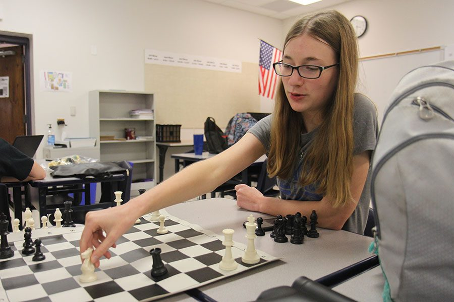 """Knight moved, Allison Abernathie (11) participates in chess club after school, Aug. 29. """"I have always enjoyed playing chess,"""" Abernathie said. """"Chess is just fun. Chess is a puzzle, but at the same time it is reacting to the other person. There is planning involved, but at the same time, your plan can fall to ruins and you're stuck looking at the board thinking, 'What should I do next?' I don't remember when I learned, but I have always enjoyed playing. Being involved in chess club allowed me to know more people at school."""""""