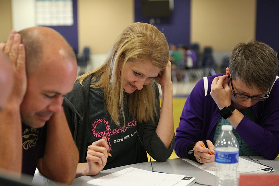 Andy Gensler, L.A.; Jessica Williams, Academic Stretch; and Cassie Rennie, Music attempt a listening task during a professional development day to teach staff about dyslexia, Aug. 10.  Teachers will be training for a new high school schedule during the four early-release dates.