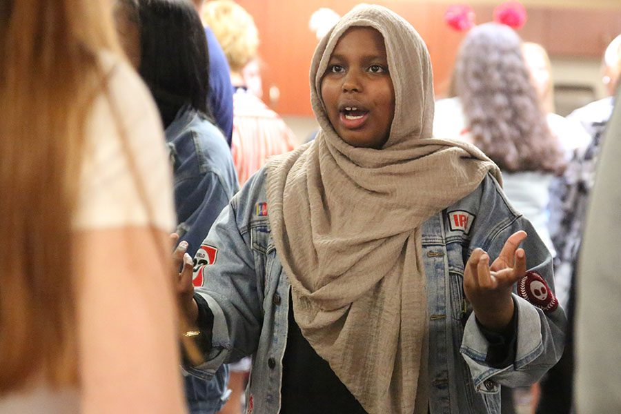 """Hands emphasizing her point, Dina Ahmed (11) talks during the E2Y2 meeting during sixth hour, Sept. 24. """"I enjoyed the fact that there were more people there. There were new faces to see, especially if you had been there for two or more years. It felt fresh with more opinions,"""" Ahmed said. """"I like that in E2Y2 I have a place to talk about things. I see a lot of these people at school everyday, but in E2Y2, I get to know them personally and their struggles. It feels like we are building a bond. We discussed how certain mindsets cycle. As you grow up, you challenge that mindset. You either conform and teach the next generation that or you challenge it and teach them something different. We talked about how we have the power to look at our challenges and our situations and change them. We all have that power, even though we might be young. You should do you. It is beneficial to talk about controversial things at school because at home, your parents might have one idea they are trying to teach you. People are constantly trying to push their ideas on you and sometimes you don't have that setting where you can speak your mind. In E2Y2, we have a mix of all sorts of people, including liberals and conservatives, rich and poor, all sorts of lifestyles, but we all have a voice."""""""