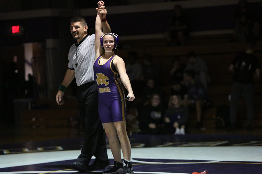 Making+history%2C+Sydney+McFadden+gets+her+arm+raised+after+winning+her+match+against+Seckman+during+the+first+ever+girls+wrestling+team+match%2C+Nov.+28.+%E2%80%9CIt+was+an+adrenaline+rush+to+win%2C%E2%80%9D+McFadden+said.+%E2%80%9CI+don%E2%80%99t+really+remember+much+of+the+match%2C+but+gaining+the+energy+from+people+up+in+the+stands+and+my+team+cheering+me+on+helped+me.+It+felt+like+I+did+something+good+for+the+school.+I+joined+the+team+because+my+family+is+a+family+of+wrestlers.+It+was+a+chance+to+make+history+and+make+my+family+proud.+My+cousin%2C+Ben+Courtney%2C+encouraged+me+to+pursue+this.+We+wrestled+each+other+ever+since+we+were+little+and+when+I+told+him+about+how+we+were+doing+this+at+my+school%2C+he+told+me+to+go+for+it%2C+so+I+did+%E2%80%9D