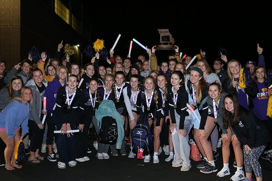 "State game over, students, staff and community members surround the girls varsity volleyball team after the team returned to EHS at midnight from their state championship game against Lafayette at the Show Me Center in Cape Girardeau, Nov. 3. ""It felt awesome to score the winning hit,"" Madison Scheer, outside hitter, said. ""I finally felt like I did something for my team. It was instant excitement after that. I was so happy. My next years here, I am going to keep trying my best and push myself. I will keep my momentum up by working hard. There are no words to describe becoming a state champion my freshman year especially because EHS has never been there before. It was awesome to be on a team who has made history. It was an amazing feeling seeing everyone waiting for us. It made us all feel important and special."" The Wildcats won in both sets, 25-23."