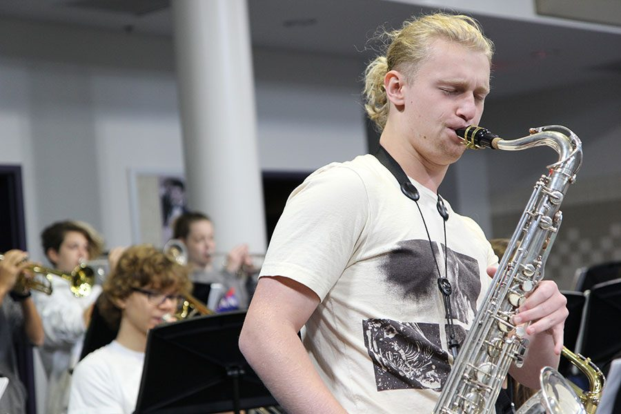 """Playing 'I'll take the 'A' train' by Billy Strayhorn, Broden Schaefer (10) plays the saxophone during Jeremy Knudtson's first hour Jazz Band class, Nov. 9. """"Jazz band is undoubtedly my favorite class,"""" Schaefer said. """"I want to be a professional musician, so it is something that motivates me to move forward. It is the reason I practice over an hour every day and pour over music theory and learn all this obscure music. I want to be the best. Playing is the best feeling ever. The rest of the day is completely affected by it. If I play well, the day gets better, but I am also hard on myself, so if I focus on my mistakes, the day gets harder. It can be a downward spiral. I started playing wind instruments in middle school, but only started the saxophone last year when Jazz Band needed me to. It hasn't been that hard of a transition. It was a little rough, but playing the saxophone made me realize that I want to be a professional musician."""""""