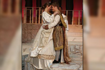 Slipper+fitting%2C+Aidan+Vogel%2C+Cinderella+and+Jack+Myers%2C+Prince+Christopher%2C+embrace+during+the+wedding+scene+of+etc%E2%80%A6%E2%80%99s+dress+rehearsal+of+Rodgers+and+Hammerstein%27s+%E2%80%9CCinderella%2C%E2%80%9D+Nov.+6.+%E2%80%9CI+have+been+doing+theatre+for+five+years+and+never+had+a+lead+role.+This+is+so+much+bigger+than+what+I+usually+play%2C%E2%80%9D+Vogel+said.+%E2%80%9CThere+is+a+lot+more+to+work+with+and+play+with+in+this+role.+It+is+so+much+fun.+I+love+being+in+theatre.+The+first+five+minutes+of+the+production+are+complete+nerves.+But+then+muscle+memory+and+adrenaline+kick+in+and+you%27re+like%2C+%E2%80%98Oh+my+god%21+I%E2%80%99m+performing.%E2%80%99+You+look+around+at+the+cast+and+you+see+they+love+it+as+much+as+you.+It%E2%80%99s+amazing.+Cinderella%E2%80%99s+whole+character+arc+is+about+a+girl+who+is+in+a+bad+situation%2C+and+she+is+using+her+imagination+to+get+through+it.+She+is+trying+to+bring+herself+joy+through+all+these+situations+she+is+imagining.+Doing+theatre+is+like+that+for+me.+I+get+to+imagine+myself+as+all+these+people.%E2%80%9D+Cinderella+is+playing+Friday%2C+Nov.+9%2C+at+7+p.m.+and+Saturday%2C+Nov.+10+at+2+p.m.+