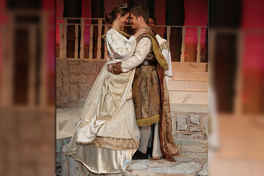 """Slipper fitting, Aidan Vogel, Cinderella and Jack Myers, Prince Christopher, embrace during the wedding scene of etc…'s dress rehearsal of Rodgers and Hammerstein's """"Cinderella,"""" Nov. 6, 2018. """"I have been doing theatre for five years and never had a lead role. This is so much bigger than what I usually play,"""" Vogel said. """"There is a lot more to work with and play with in this role. It is so much fun. I love being in theatre. The first five minutes of the production are complete nerves. But then muscle memory and adrenaline kick in and you're like, 'Oh my god! I'm performing.' You look around at the cast and you see they love it as much as you. It's amazing. Cinderella's whole character arc is about a girl who is in a bad situation, and she is using her imagination to get through it. She is trying to bring herself joy through all these situations she is imagining. Doing theatre is like that for me. I get to imagine myself as all these people."""" Cinderella is playing Friday, Nov. 9, at 7 p.m. and Saturday, Nov. 10 at 2 p.m."""