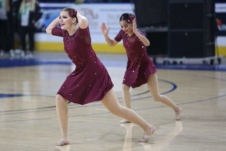 """Last competition of her career, Sarah Emery (12) dances with Golden Line at the St. Charles Competition, Feb. 23. """"It is eye opening leaving Golden Line,"""" Emery said. """"You spend so much time with your teammates and that is what I am going to miss most. I don't know how much I will miss being busy all the time and having no free time, but I will miss dancing. I am not continuing my career and that is hard."""" Emery will study physical therapy at the University of Kansas in the fall."""