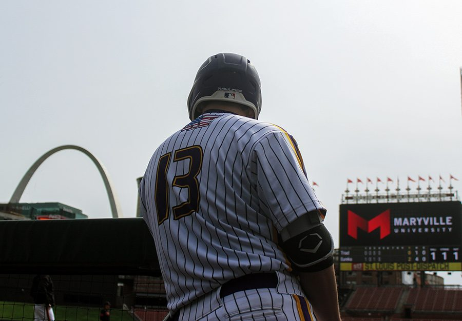 Hunter Mulholland, catcher, gets ready to go hit in Eurekas game against Triad High School at Busch Stadium, April 13. The Wildcats won, 6-3.