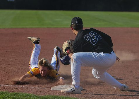 Zach Holtz, third baseman, dives into third base during Eureka