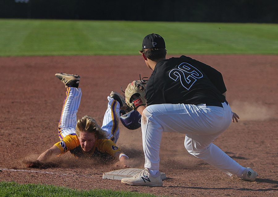 Zach Holtz, third baseman, dives into third base during Eureka's game against Rockwood Summit, April 17. EHS lost, 16-13.