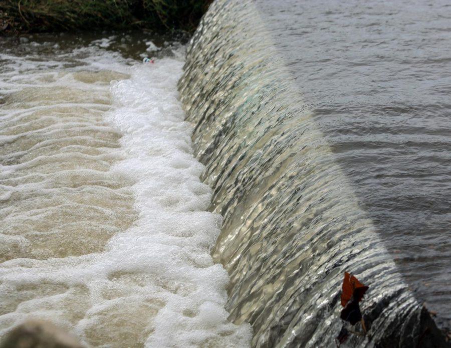 Water rushes toward the storm drain at Eureka High School, Aug. 26.