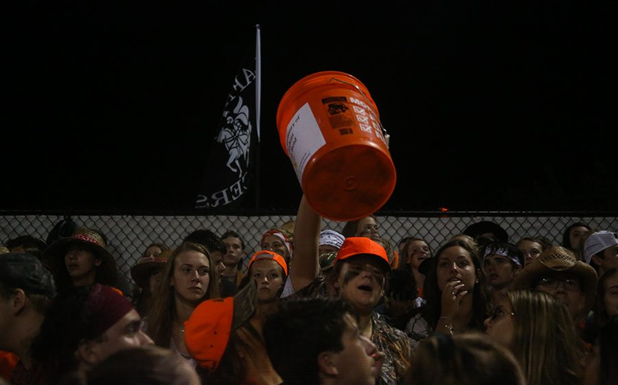 Students raise up the bucket to collect money in the Catpound during the EHS vs. LHS football game, Sept. 20. The EHS students raised over $1,000.