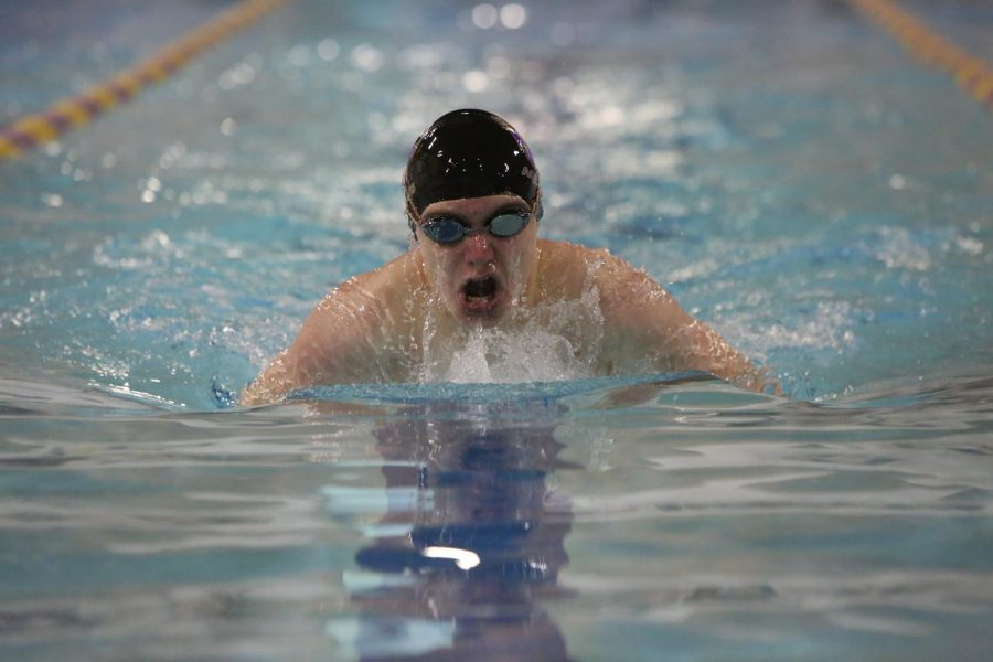 Coming up from the water, Rowan Peckham (11) races in the varsity swim meet against CBC, October 22. Wildcats won 97-89.