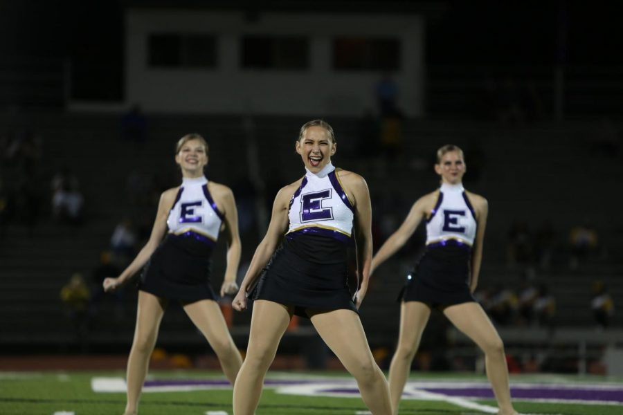 E on her chest, Maddie Bee(11) dances with Golden Line during the Hazelwood Central game, Sept. 13.