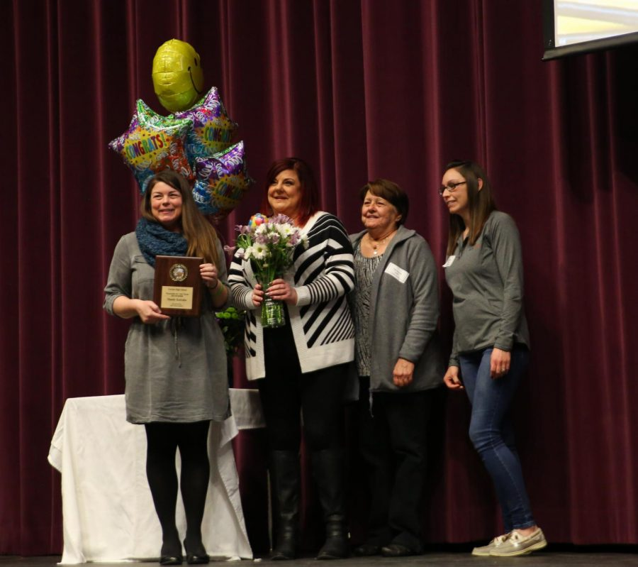 Mandy Kotraba, Science, stands alongside her sister (left), mother, and sister-in-law after winning the TOY award, Feb. 18.