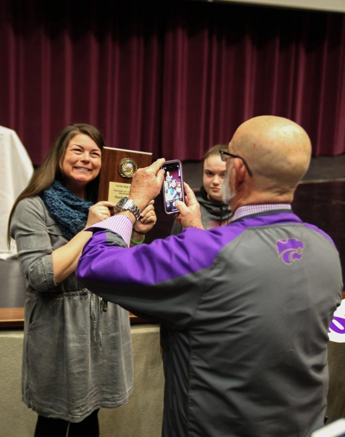 Charlie Crouther, principal, takes a photo of Mandy Kotraba, Science, after Kotraba was announced as the 2020 Teacher of the Year at EHS, Feb. 18.