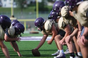 Linemen get set in formation at boy's varsity football practice Thursday,  Sept. 3.
