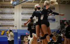 Eureka's volleyball team celebrates on the court while playing Lafayette, Oct 27.
