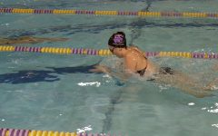 Dani Glass swims breast stroke in Eureka's meet against Washington, December 1.