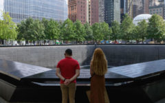 A couple stands before the National September 11 Memorial, marking the site of the south tower at the World Trade Center in New York, on September 8, 2021. - The remains of two more victims of 9/11 have been identified, thanks to advanced DNA technology, New York officials announced on September 7, 2021, just days before the 20th anniversary of the attacks. (Angela Weiss/AFP via Getty Images/TNS)